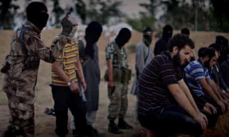 Screengrab showing militant apparently about to shoot kneeling prisoners in the head