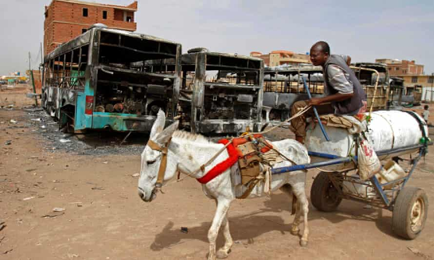Donkey cart passes burned buses
