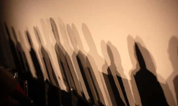 """Shadows of members of a panel are seen on a wall before a meeting about the """"right to be forgotten"""""""
