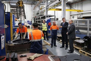British Prime Minister David Cameron (2nd R) visits Weir Minerals factory near Yateley in Hampshire on September 17, 2014.