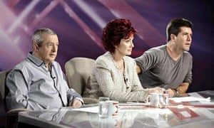 The X Factor judges (left-right) Louis Walsh, Sharon Osbourne and  Simon Cowell