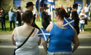 Saltires on display during the parade.