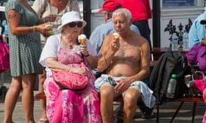 Couple eating ice-creams in sun