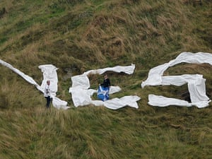 Yes supporters place a large YES on Salisbury Crag in Edinburgh.