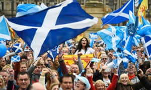 Campaigners wave Scottish Saltires at a 'Yes' campaign rally in Glasgow.