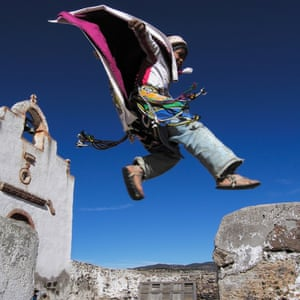 Chihuahua, Mexico: A Tarahumara Indian is dressed as a Matachines dancer from the Dance of the Moors and the Christians during the San Guadalupe pilgrimage at a church in Nararachi village