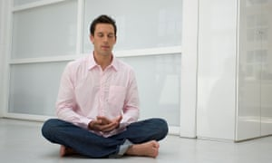 portrait of calm man meditating in office environment