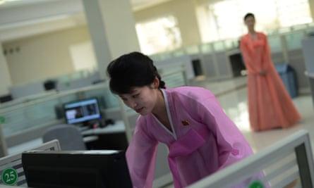 A North Korean woman checks a computer a at music software company in Pyongyang.