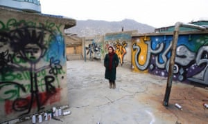 Shamsia Hassani photographed on the roof of her graffiti workshop.