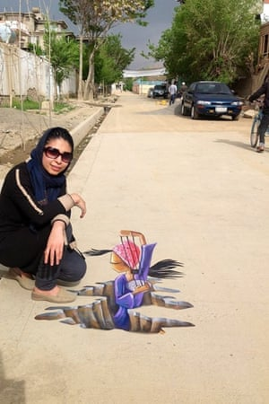 Shamsia Hassani, pictured by what's considered the first ever piece of 3D street art in Afghanistan,