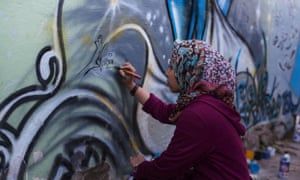 Shamsia paints at The Venue, Kabul.