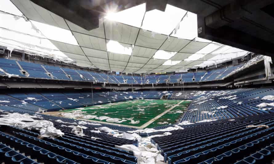Interior of the Pontiac Silverdome: the venue is a shell of its former self with its roof in tatters.