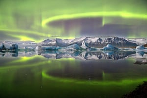 Aurora over a Glacier Lagoon  James Woodend (UK), Earth and Space: winner and overall winner  A vivid aurora over Iceland's Vatnajökull national park. A lack of wind and current combine to create an arresting mirror effect, giving an impression of utter stillness