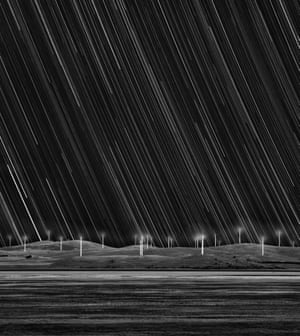 Wind Farm Star Trails  Matt James (Australia), Earth and Space: runner-up  Capital Wind Farm on the shore of Lake George, near Bungendore in Australia. The stars have been transformed into a shower of trails as the Earth rotates in this long-exposure, black-and-white image