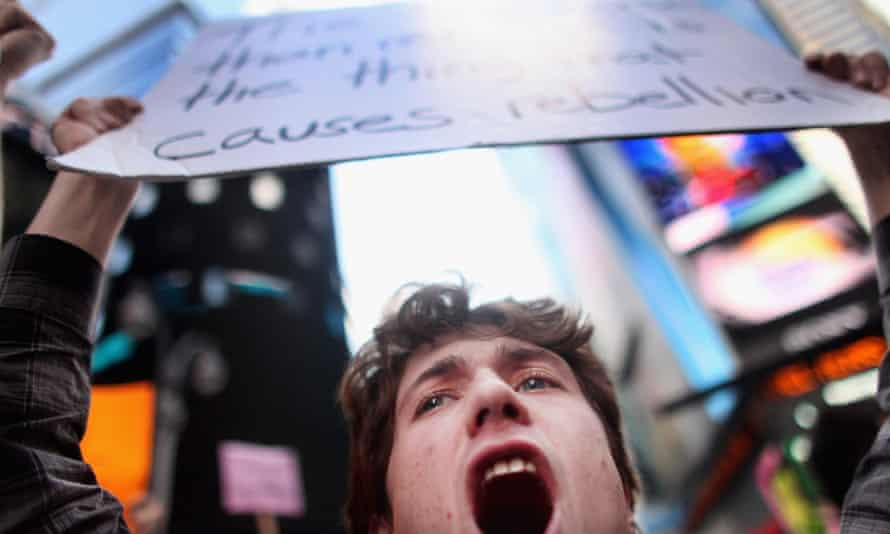 A demonstrator shouts in Times Square.