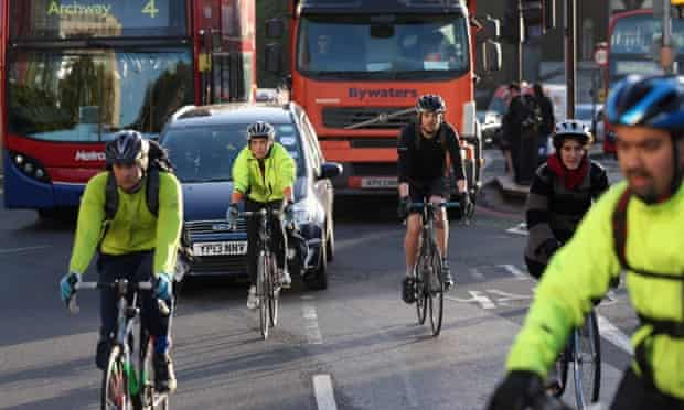 The way it is now: cyclists in rush hour traffic near Waterloo Station in London.