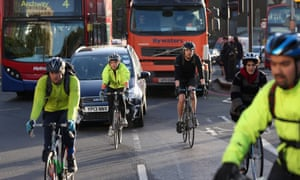 Cyclists negotiate rush hour traffic near Waterloo Station.