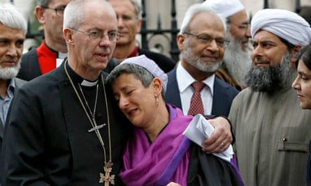 Justin Welby puts arm round Rabbi Laura Janner-Klausner at a rights vigil