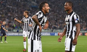 Carlos Tevez of Juventus celebrates the opening goal with his team-mate Patrice Evra.