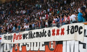 Ajax fans display a banner during their 1-1 draw with PSG.