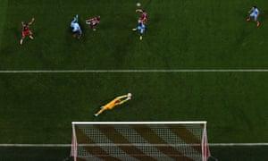 Manchester City's Joe Hart claws the ball away from a Bayern Munich header.