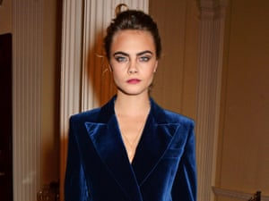 Cara Delevingne attends a London Fashion Week party in a velvet jacket