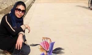 Shamsia beside what's reckoned to be the first ever piece of 3D street art on Afghanistan.