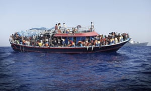 Migrants are taken to the mainland after being rescued by the Italian navy