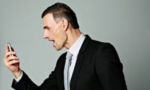 Angry businessman shouting at his smartphone
