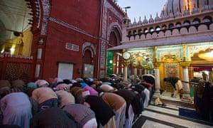 Praying at Hazrat Nizamuddin Dargah Muslim Shrine in Old Delhi India