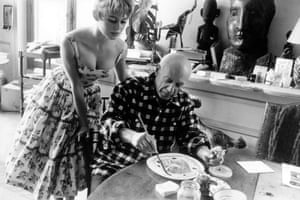 Brigitte Bardot watching Pablo Picasso at work in his studio in Vallauris during the 1956 International Cannes film festival.