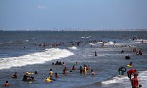 Egyptians swim in the Mediterranean sea