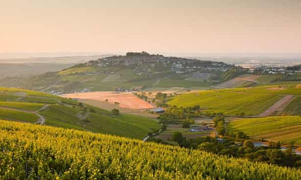 Dawn light starts to fill the skies above the village and vineyards of Sanerre.