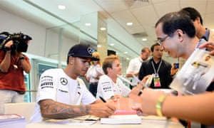 Lewis Hamilton and Nico Rosberg at an F1 autograph signing session in Singapore