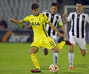 Ben Davies has struggled tonight but here moves the ball clear from Grbic and Ilic.