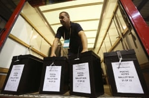 A man carries ballot boxes at a counting centre in Edinburgh.