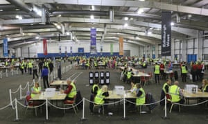 Members of staff wait inside a counting centre to begin tallying votes in Edinburgh.