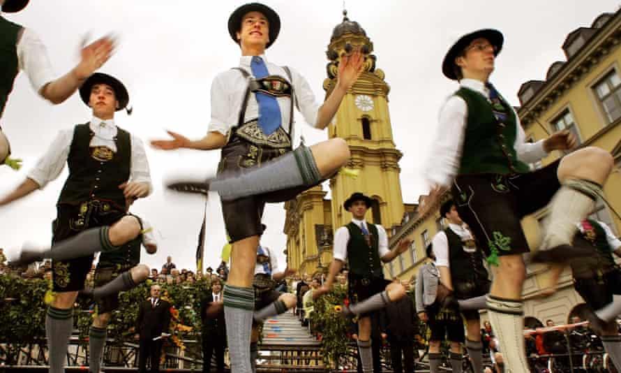 Men dance the schuhplattler during a parade at Munich's Oktoberfest beer festival.