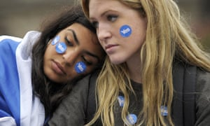 Pro-independence supporters console each other after a no vote in the Scottish referendum