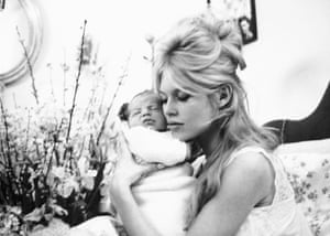 On 11 January 1960 Bardot gave birth to her only child, Nicolas. Here she is cuddling him in her Paris apartment.