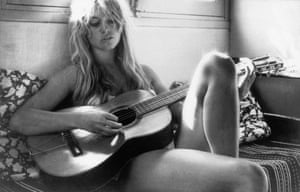 Bardot's love of music led to her releasing several records in the 60s and 70s. Here she is playing guitar in Saint-Tropez.
