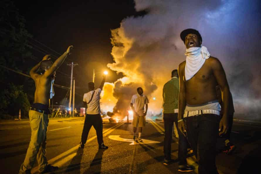 Demonstrators face tear-gas during protests in Ferguson, Missouri.