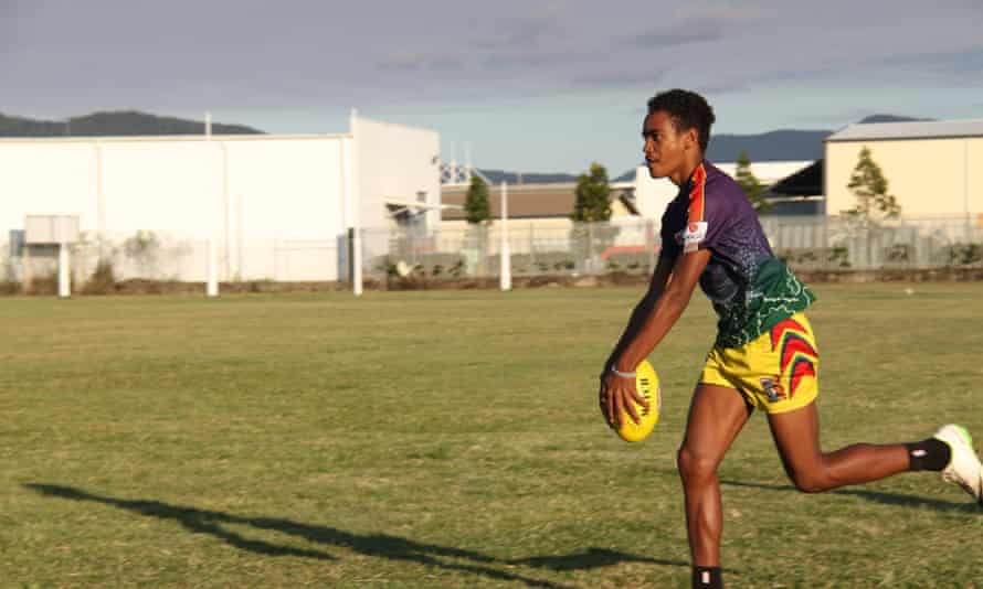 Laurie Nona shoots for goal during a training session at AFL Cape York House in Cairns. Credit: Sam Davis Laurie Nona shoots for goal during a training session at AFL Cap