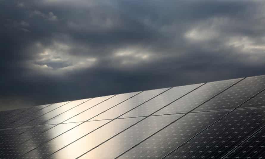 Solar panels under stormy sky