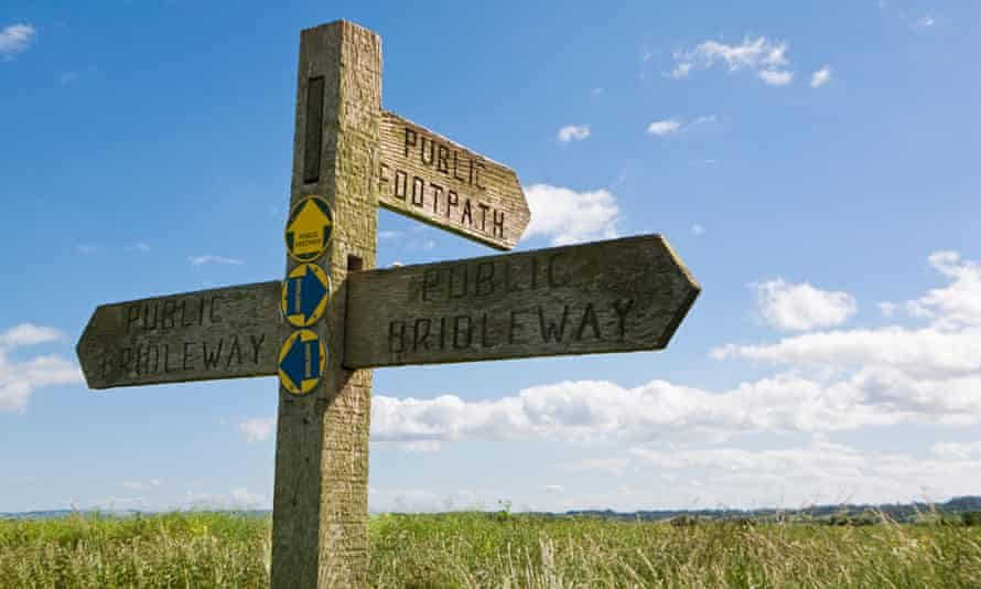 A signpost indicating public footpaths in Marshlands, East Yorkshire.