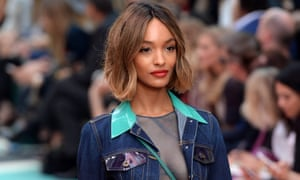 British model Jourdan Dunn presents creations from the Spring/Summer 2015 collection by Burberry Prorsum