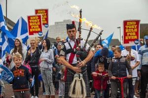 20 photos: Piper Ryan Randall leads a pro-Scottish