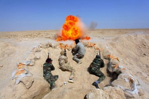 20 photos: Shi'ite fighters take part in field training in Najaf