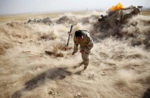 20 photos: A Kurdish Peshmerga fighter launches mortar shells towards Zummar