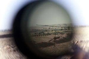 20 photos: The horizon seen through a telescopic rifle belonging to Kurdish Peshmergas
